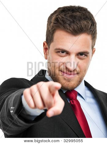 Handsome businessman pointing his finger at you