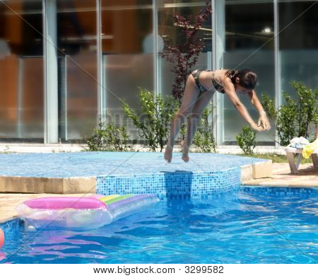 Young Girl Diving In The Pool