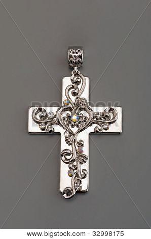 Silver cross on gray