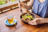 Woman Eating Quinoa Salad. Eat Healthy Food Lifestyle Concept With Beautiful Young Woman poster
