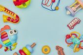 Top View On Childrens Toys On A Blue Background. Childrens Toys On The Table. Concept For Advertisin poster