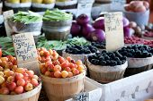 pic of farmers market vegetables  - An image of a variety of fruits and vegetables at an outdoor farmer