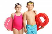 Children in swimming suits holding swimming pads isolated on white background poster