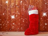 Christmas Fluffy Stocking Standing Near Wooden Wall. View With Copy Space. poster
