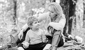 Natural Beauty. Happy Son With Mother Relax In Autumn Forest. Family Picnic. Mothers Day. Spring Moo poster