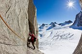 A male young climber along a pitch on the south face of Mont Blanc massif. Petit Capucin, Mont Blanc
