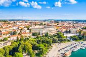 Croatia, City Of Pula, Ancient Roman Arena, Historic Amphitheater And Old Town Center Fron Drone, Ae poster