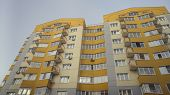 Modern Apartment Buildings On A Sunny Day With A Blue Sky. Facade Of A Modern Apartment Building. Re poster