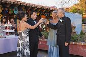 picture of quinceanera  - Hispanic couples toasting at Quinceanera - JPG