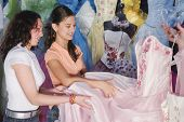 picture of quinceanera  - Hispanic girls looking at Quinceanera dress - JPG
