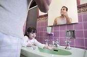 pic of mixing faucet  - Father shaving with daughter at sink - JPG