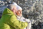 Close Up Portrait Of Happy Senior Couple Hugging poster