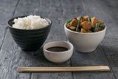 A Bowl Of Rice, A Bowl Of Tofu And A Bowl Of Soy Sauce. Vegetarian Asian Dish. poster