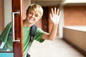 stock photo of bye  - cute high school boy waving good bye - JPG