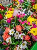 Bouquets Of Flowers In The Supermarket . Ready-made Bouquets. Flowers On The Occasion. Beautiful Bri poster