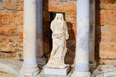 Marble Statues At The Columns Of The Amphitheater In Hierapolis, Turkey. Ancient Antique Amphitheate poster