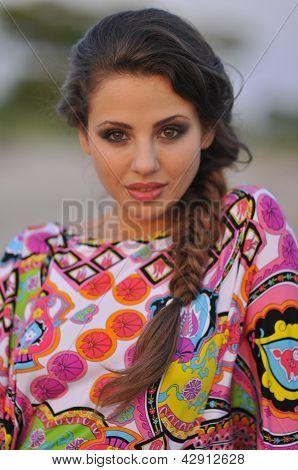 Beautiful brunette model posing pretty at tropical beach