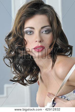 Portrait of blue eyed brunette looking pretty