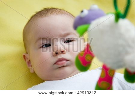 Baby Looking Up At A Mobile Toy