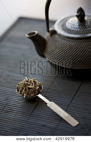Spoon Of Green Tea And Teapot