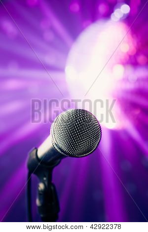 microphone against shiny disco background