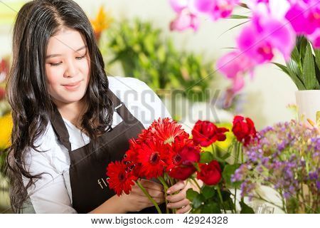 Friendly Asian florist or Saleswoman in a flower shop