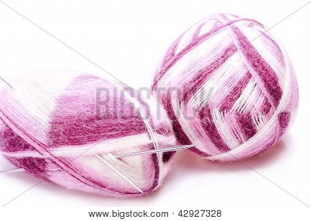Varicolored Balloons Of Yarn With Knitting Needles