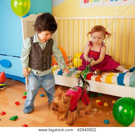 Kids Playing With Dog And Having Party