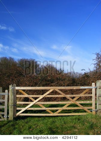 Rural Wooden Five Bar Gate Against Blue Sky