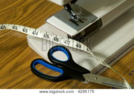 Sewing Machine, Scissors, And Tape Measure