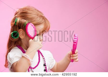 Little Girl Playing A Hairdresser