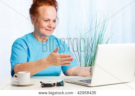 Senior Lady Pointing To The Screen
