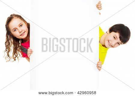 Two Kids With Blank Ad Board