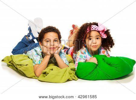 Kids Laying On Pillows