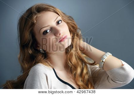 Portrait Of A Beautiful Blonde Young Woman In Studio