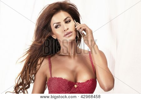 Portrait Of Attractive Brunette Girl Talking On Mobile Phone.