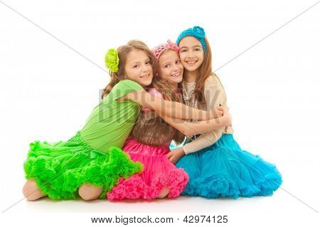 group of young friends hugging smiling and happy