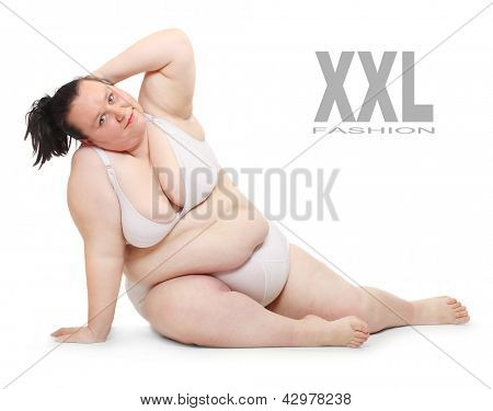 Overweight woman dressed in bikini on white background.