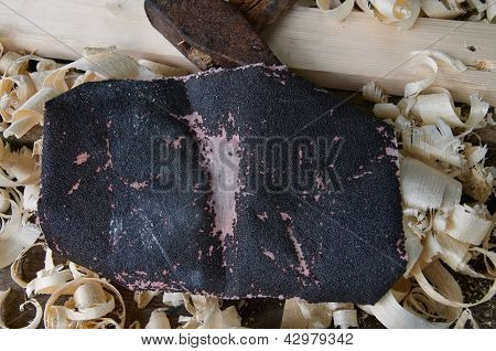 Emery Cloth, An Old Hammer, Board And Wood Shavings