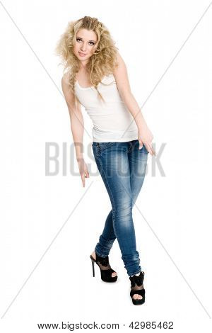 Stylish young blonde girl in a white t-shirt dancing hip hop.
