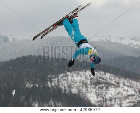 BUKOVEL, UKRAINE - FEBRUARY 23: Sergei Berestovskiy, Belarus performs aerial skiing during Freestyle Ski World Cup in Bukovel, Ukraine on February 23, 2013