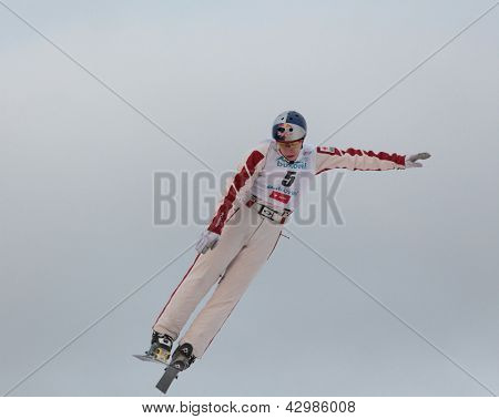 BUKOVEL, UKRAINE - FEBRUARY 23: Travis Gerrits, Canada performs aerial skiing during Freestyle Ski World Cup in Bukovel, Ukraine on February 23, 2013