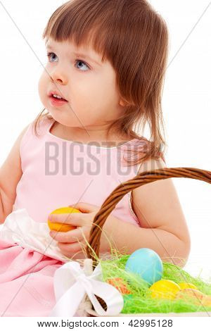 little girl playing with eater eggs