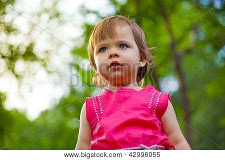 cute little girl stading in the park