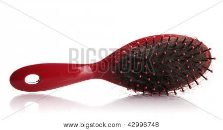 comb brush with lost hair, isolated on white