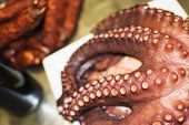 stock photo of table manners  - octopus cooked and presented in the table with accessories - JPG