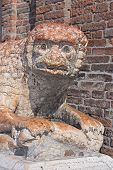 pic of ferrara  - sculpture of a lion holding a snake with legs  - JPG