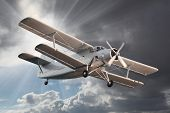 foto of propeller plane  - Retro style picture of the biplane - JPG
