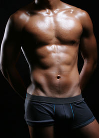 picture of bulging belly  - hunky asian young man in boxer trunks and hands behind - JPG