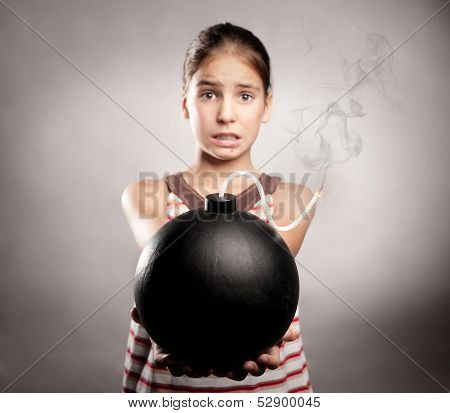 scared little girl holding an old fashioned bomb